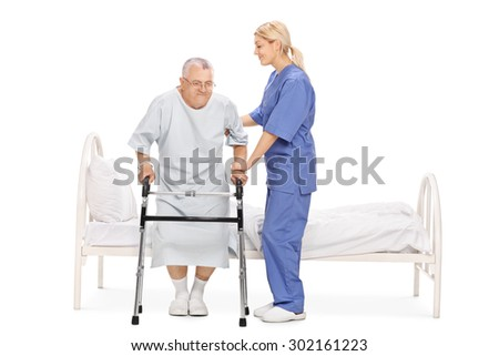 Young female nurse helping a senior patient with a walker isolated on white background - stock photo