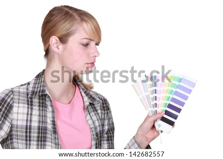 young female painter holding color chart - stock photo