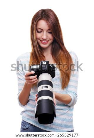 Young female photographer taking photos isolated on white - stock photo