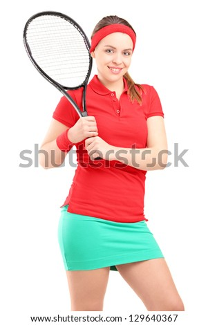 Young female posing with a tennis racket isolated on white background - stock photo