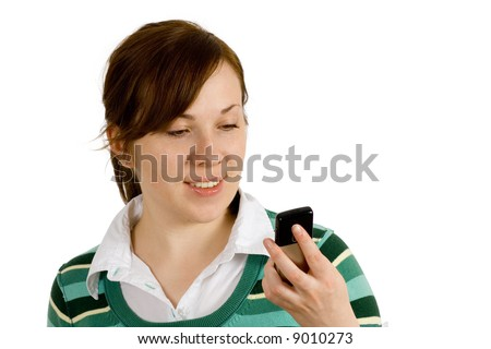 young female reading text message on her mobile phone, with smile on her faces, isolated on white background - stock photo