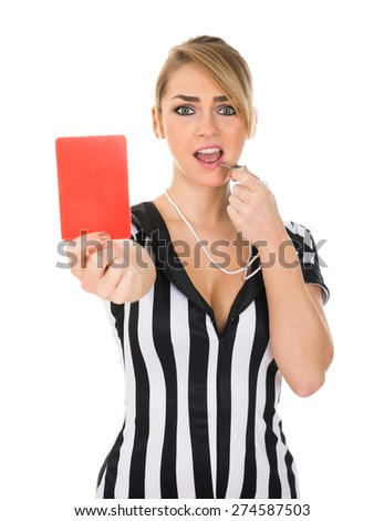 Young Female Referee Holding Red Card Over White Background - stock photo