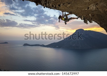 Young female rock climber at sunset, Kalymnos Island, Greece  - stock photo