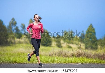 Young female running outdoors. - stock photo