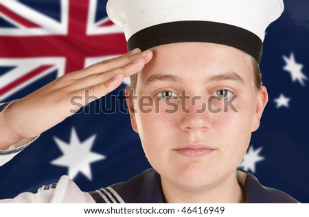 young female sailor saluting in front of australian flag - stock photo