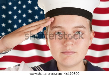 young female sailor saluting in front of US flag - stock photo