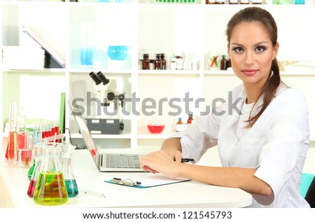 Young female scientist in  laboratory - stock photo