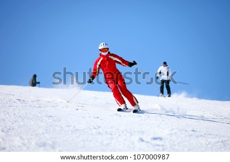 Young female skier on a mountain slope - stock photo
