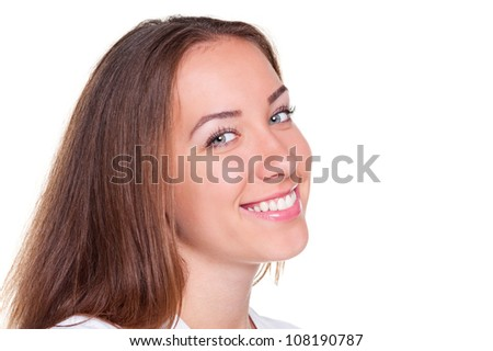 young female smiling and looking at camera over white background - stock photo