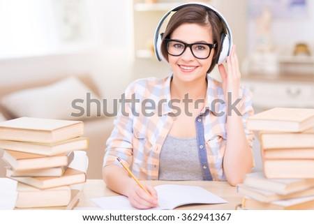 Young female student doing audio exercises.  - stock photo