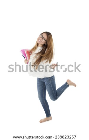 Young female student posing while holding notebook against a white background - stock photo
