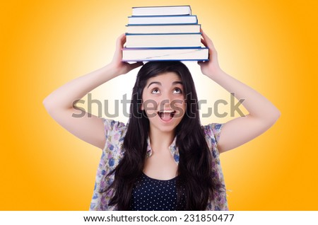 Young female student with books on white - stock photo