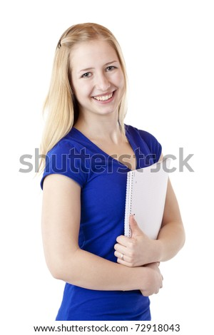 Young female student with writting pad smiles happy. Isolated on white background. - stock photo