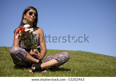 young female teenager holding a bouquet of red and white flowers - stock photo
