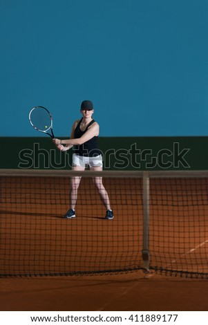 Young Female Tennis Player With Racket Ready To Hit A Tennis Ball - stock photo