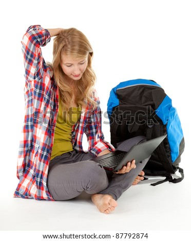 young female tourist with backpack and map, white background - stock photo