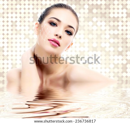 Young female with clean fresh skin, abstract background - stock photo