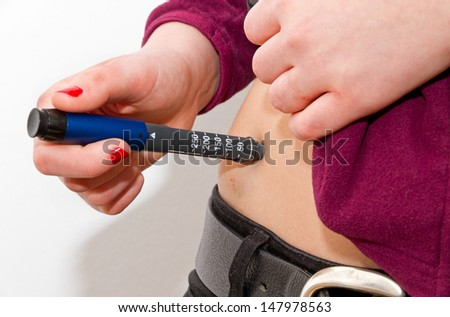 Young female with diabetes patient make a subcutaneous  - stock photo