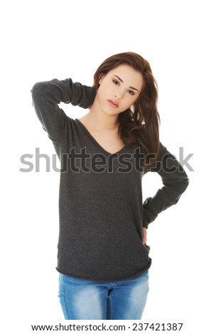 Young female with neck pain - stock photo
