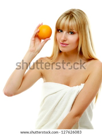 Young female with orange isolated on white - stock photo