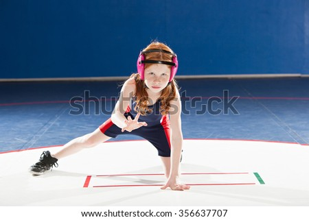 Young female wrestler in her stance - stock photo