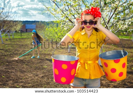 Young females working on garden - stock photo