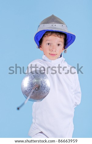 Young fencer with rapier - stock photo