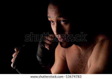 Young fighter male holding guard - stock photo