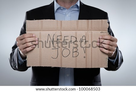 Young fired businessman looking for a job - stock photo
