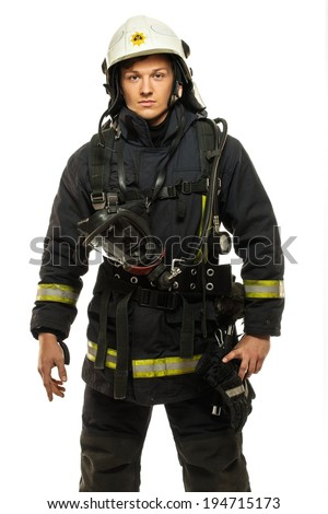 Young firefighter wearing helmet isolated on white  - stock photo