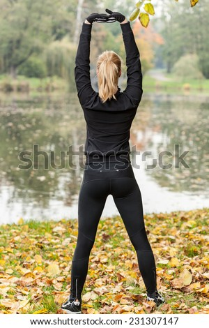Young fit woman and her break during autumn jogging - stock photo