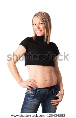 Young fit woman with toned body posing in studio - stock photo