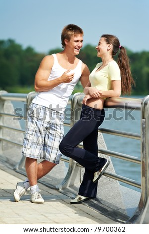 Young fitness couple of man and woman relaxing after jogging sport outdoors - stock photo