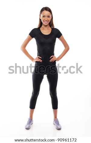 young fitness trainer standing isolated over white background - stock photo
