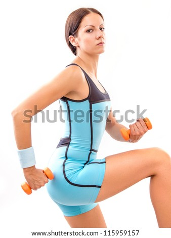 Young fitness woman exercising with small dumbell - stock photo