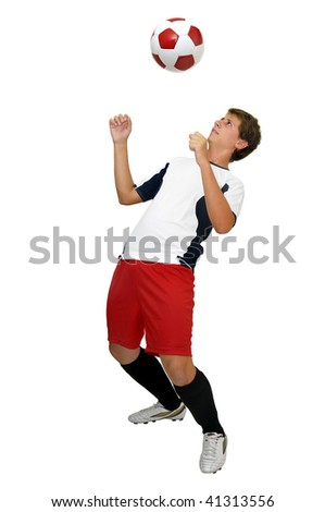 Young football player with a ball isolated in white - stock photo