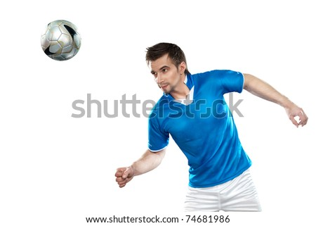 Young football player with ball on isolated background - stock photo