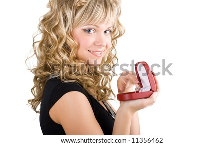 young friendly blond girl holding box with wedding ring - stock photo