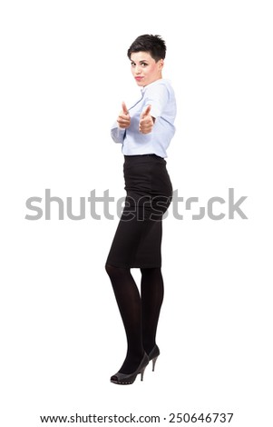 Young friendly businesswoman showing thumbs up sign looking at camera. Full body length portrait isolated over white background. - stock photo