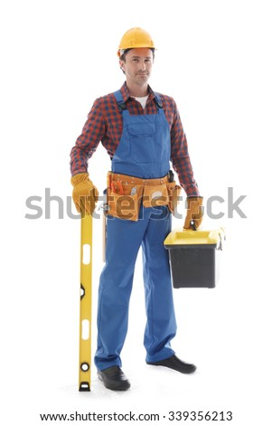 Young friendly manual worker with tools isolated on white background - stock photo