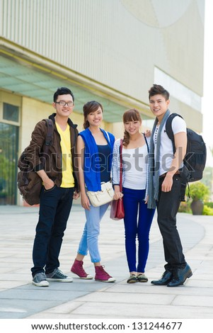 Young friendly team standing together outdoors - stock photo