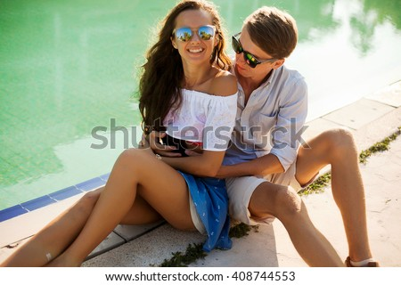 Young friends funny guys active people have fun together woman and man, girl and guy summer urban casual style.summer style couple outfit.  - stock photo