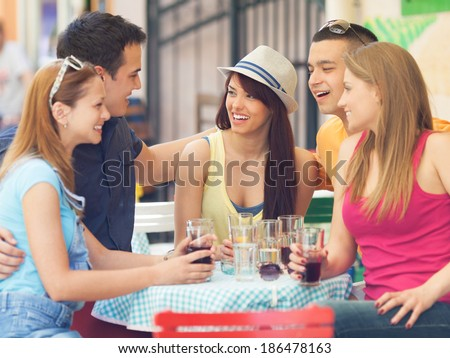 Young friends in a cafe - stock photo