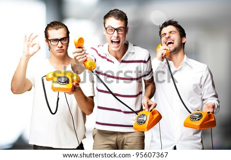 young friends talking on vintage telephone indoor - stock photo