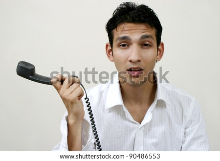 young frustrated man with phone - stock photo