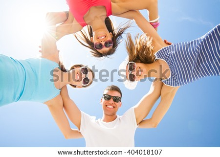 Young fun people are having good time on the beach - stock photo