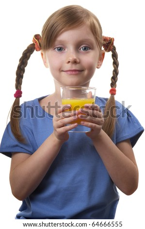 Young funny girl with a glass of juice over white background - stock photo