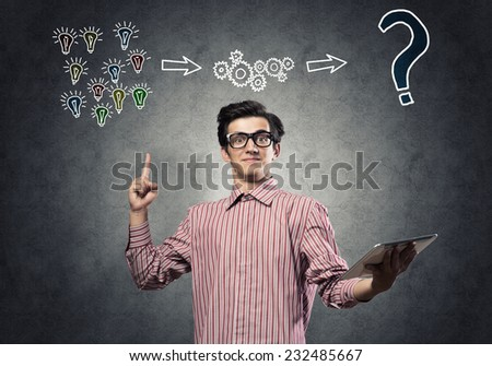 Young funny man in casual with tablet in hand - stock photo