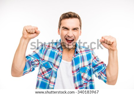 Young furious man shouting and showing fists - stock photo