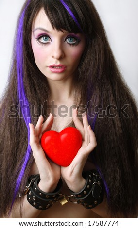young gerl with heart and lock - stock photo